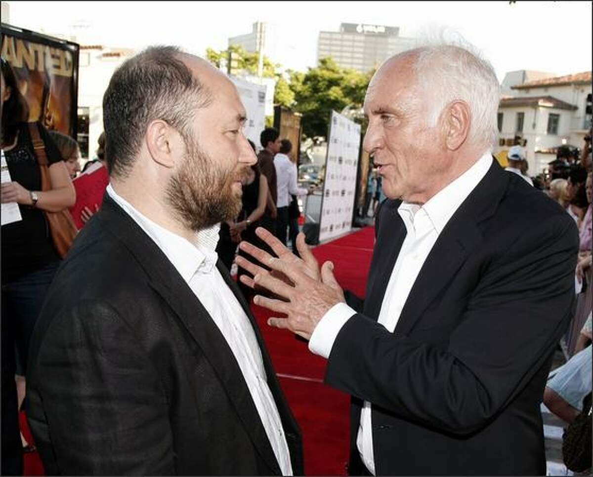 """Director Timur Bekmambetov (L) and actor Terence Stamp arrive at the opening of the Los Angeles Film Festival with the premiere of Universal's """"Wanted"""" at the Village Theater in Los Angeles, California."""