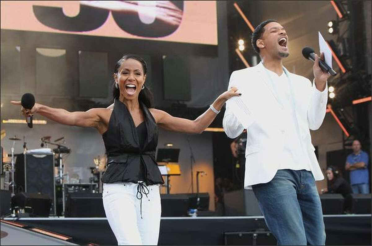 Actor Will Smith and actress Jada Pinkett Smith onstage.