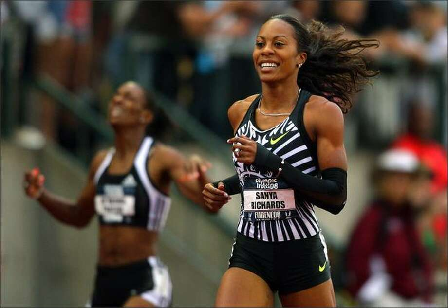 Sanya Richards smiles as she crosses the line to win the women's 400 meter finals. Photo: Getty Images