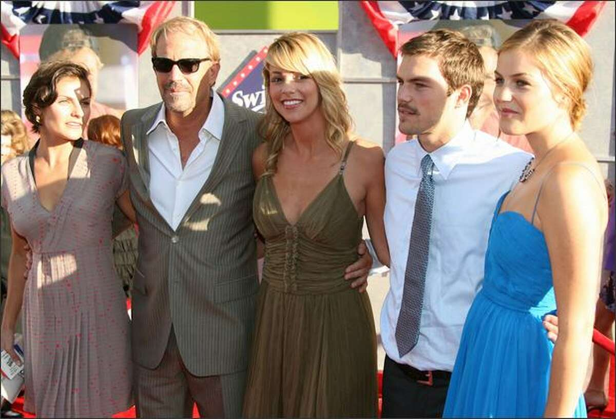 Actor Kevin Costner poses with family at the premiere of