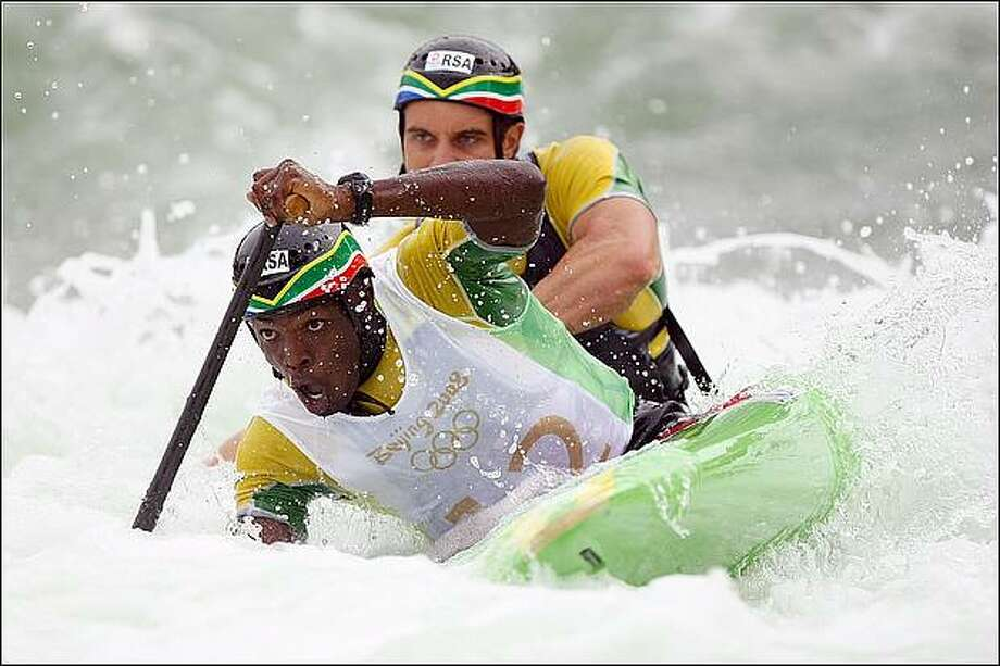 Cameron McIntosh and Cyprian Ngidi of South Africa compete in the canoe/kayak slalom event at the Shunyi Olympic Rowing-Canoeing Park during Day 5 of the Beijing 2008 Olympic Games in Beijing, China. (Photo by Jed Jacobsohn/Getty Images)