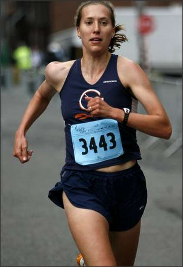 Sarna Becker finished first in the Women's 5k at Puget Sound Susan G. Komen Race for the Cure outside of Qwest Field, Saturday, June 21, 2008. The race helps to raise money for breast cancer research, education and treatment. Photo: Kristine Paulsen, Seattle Post-Intelligencer