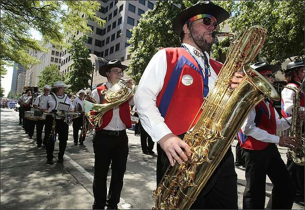 Members of the Rainbow City band play in the Gay Pride Parade.