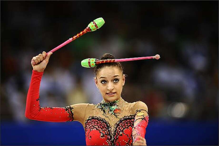 Russia's Evgeniya Kanaeva competes in the individual all-around qualification of the rhythmic gymnastics at the Beijing 2008 Olympic Games in Beijing.