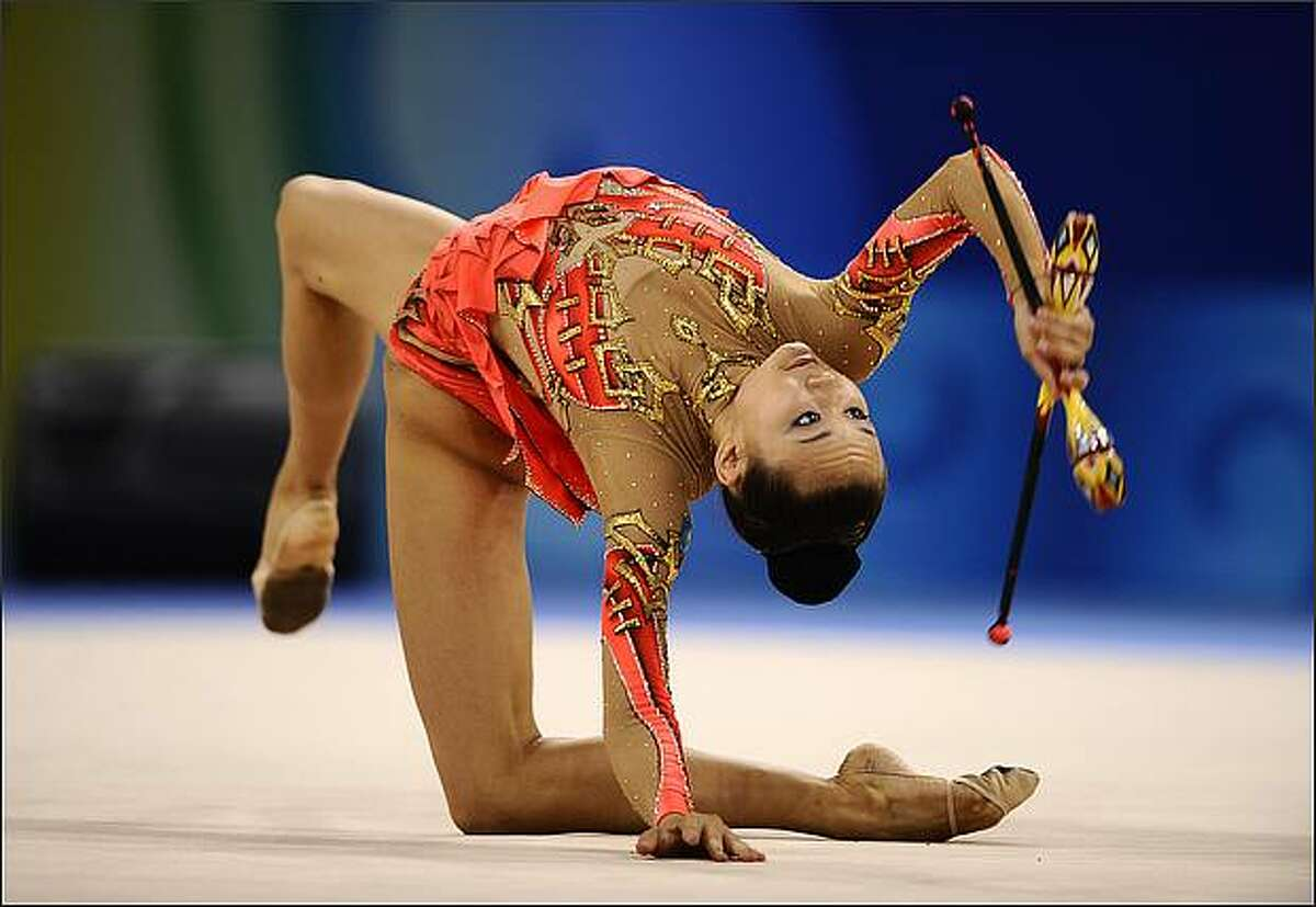 Kazakhstan's Aliya Yussupova competes in the individual all-around qualification of the rhythmic gymnastics at the Beijing 2008 Olympic Games in Beijing.