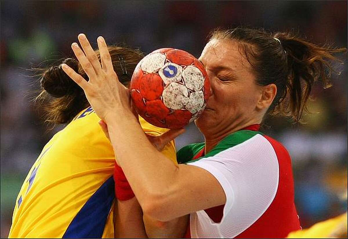 Timea Toth (R) of Hungary is tackled by Sara Holmgren of Sweden during the handball match between Hungary and Sweden held at the Olympic Sports Center Gymnasium during day 1 of the Beijing 2008 Olympic Games in Beijing, China.