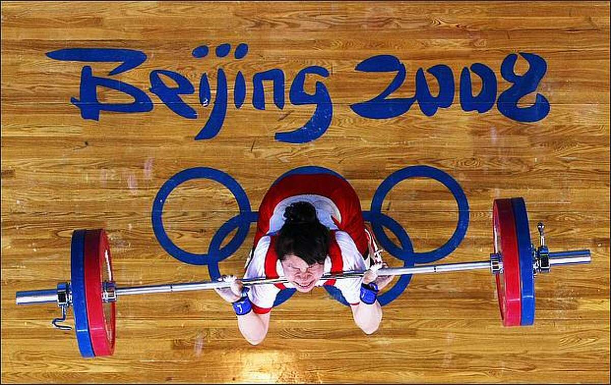 Hiromi Miyake of Japan competes in the Women's 48kg Group A Weightlifting event held at the Beijing University of Aeronautics and Astronautics Gymnasium on Day 1 of the Beijing 2008 Olympic Games in Beijing, China.
