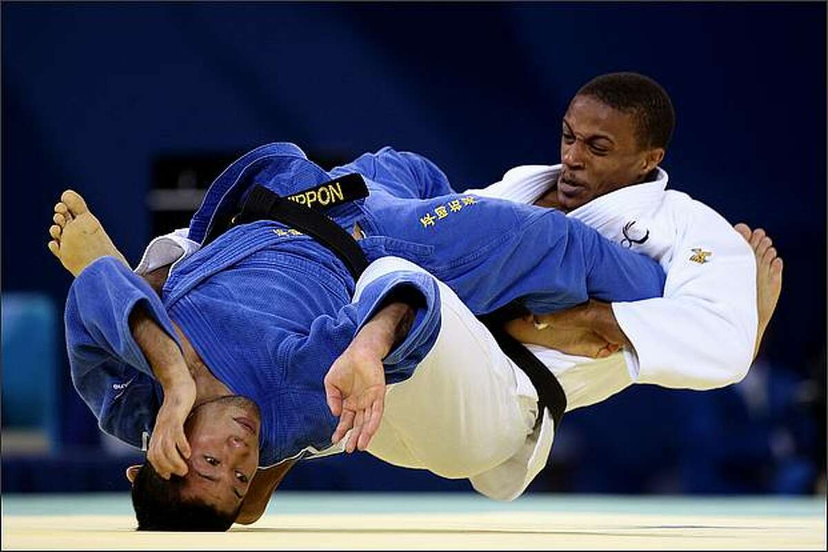 Hiroaki Hiraoka (L) of Japan competes against Taraje Williams-Murray of the United States during their 60 kg preliminary judo bout at the Beijing Science and Technology University Gymnasium during Day 1 of the Beijing 2008 Olympic Games in Beijing, China. Williams went on to win the bout 1-0.