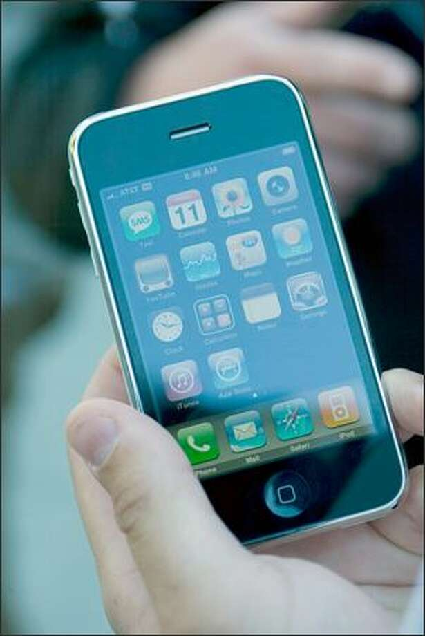 A 16 GB iPhone 3G is displayed outside the University Apple Store on Friday in Seattle. Over 400 waited in line, some since 5:30 pm the evening before, to purchase the popular phone. Photo: Jim Bryant, Seattle Post-Intelligencer