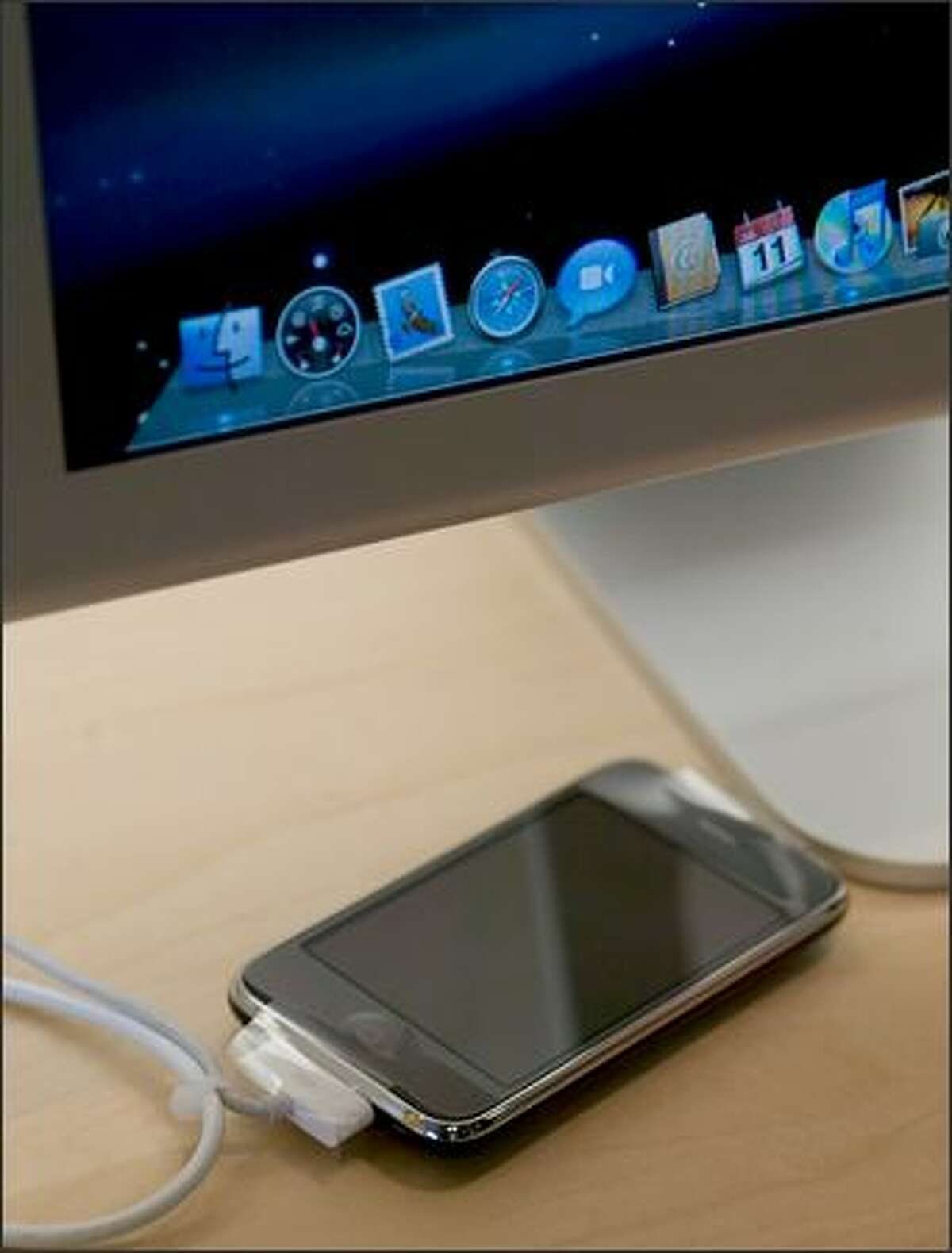 An iPhone 3G waits to be activated at the University Village Apple Store on Friday in Seattle.