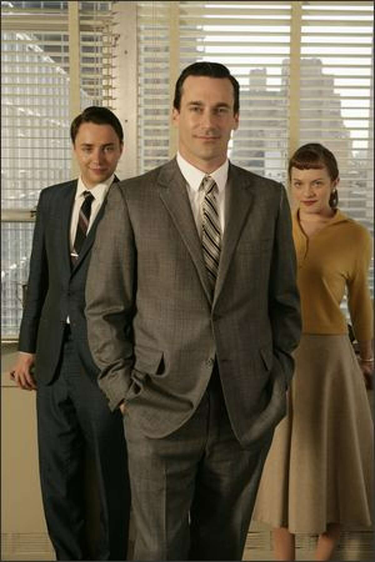 """Vincent Kartheiser, Jon Hamm and Elisabeth Moss star in the AMC drama series """"Mad Men."""" The show as nominated for Best Drama and Hamm was nominated for Best Actor in a Drama Series."""