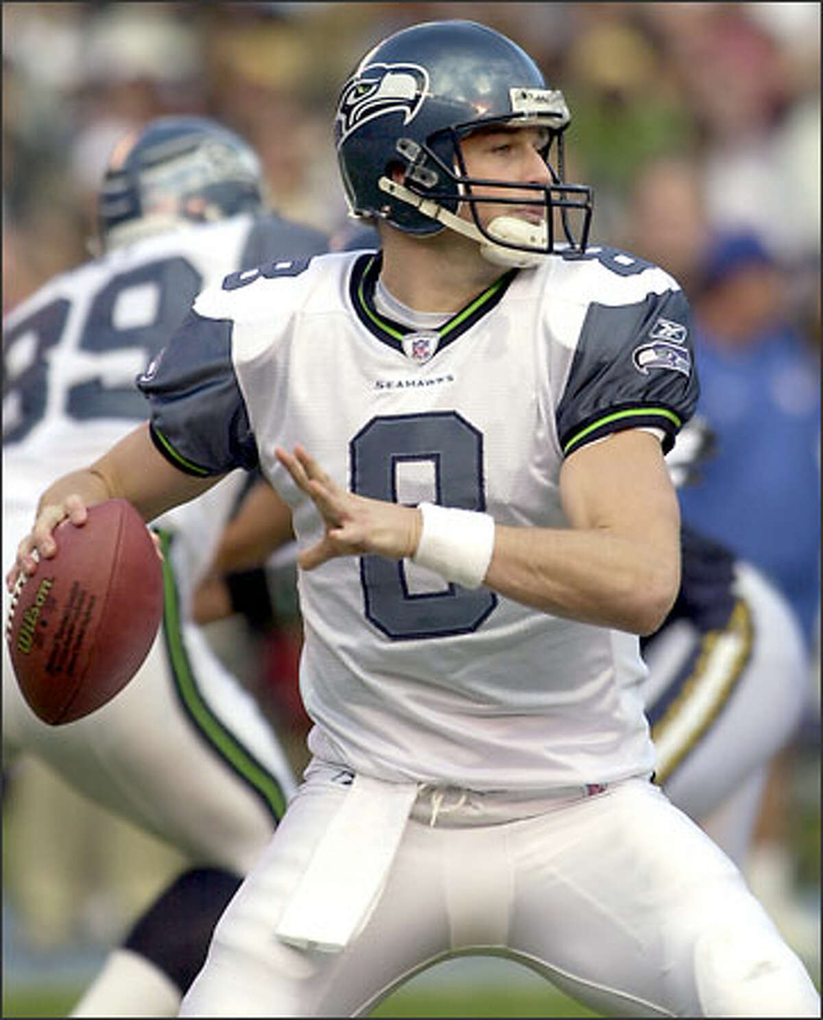 Matt Hasselbeck threw two touchdown passes, lead the Seahawks to a 31-28 comeback victory in overtime.
