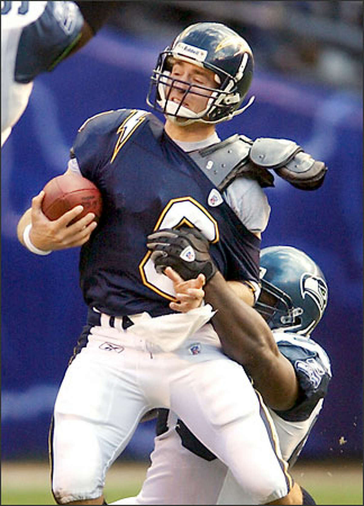 Seahawks tackle John Randle sacks San Diego quarterback Drew Brees for a 9-yard loss during the first quarter. Randle dropped Brees three times.