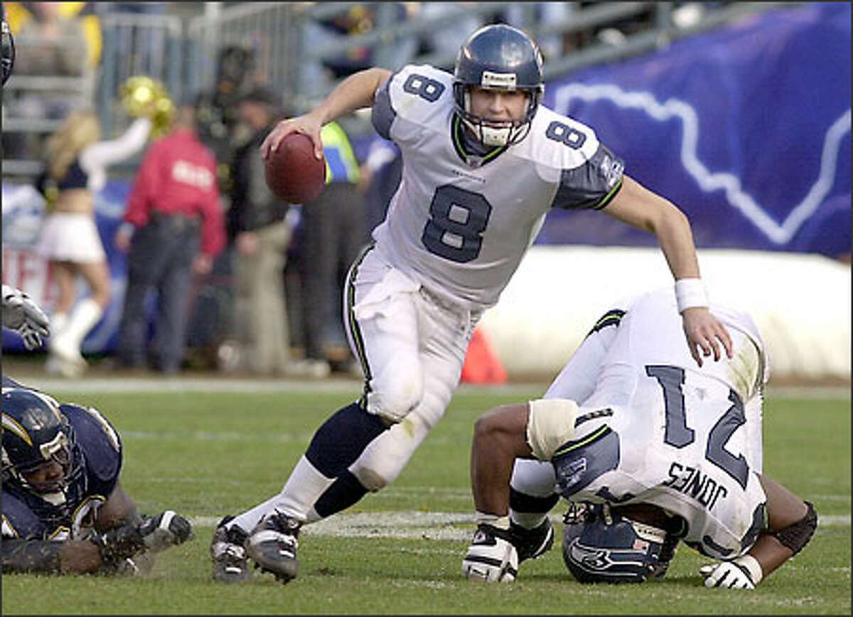 Matt Hasselbeck scrambles for a first down behind the blocking of Seahawks left tackle Walter Jones. Hasselbeck passed for a team record 449 yards against the Chargers.