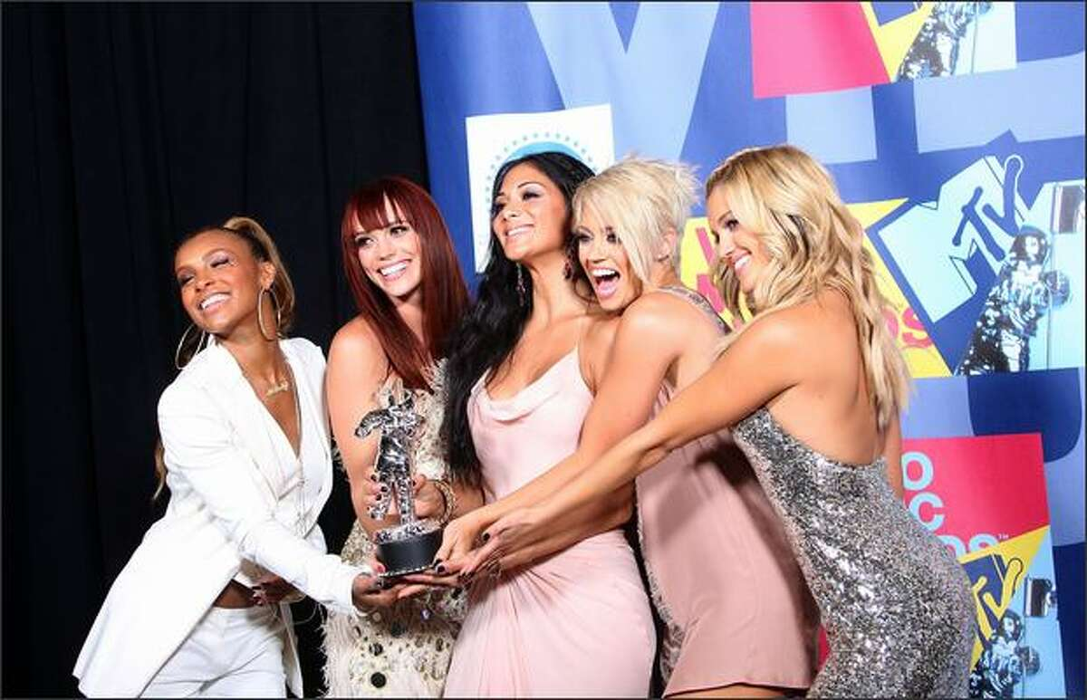 Members of The Pussycat Dolls pose with the Best Dancing in a Video award for