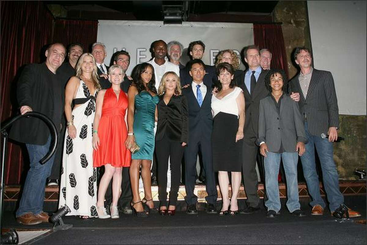 """Cast of TV Show Heroes pause at NBC's Countdown To The Premiere Of """"Heroes"""" on Sunday in Los Angeles, Calif."""