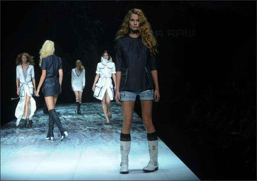 A model walks the runway at the G Star show.