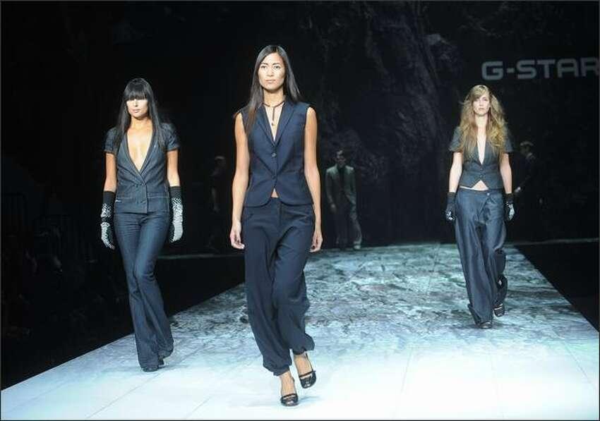 Models walk the runway at the G Star show.