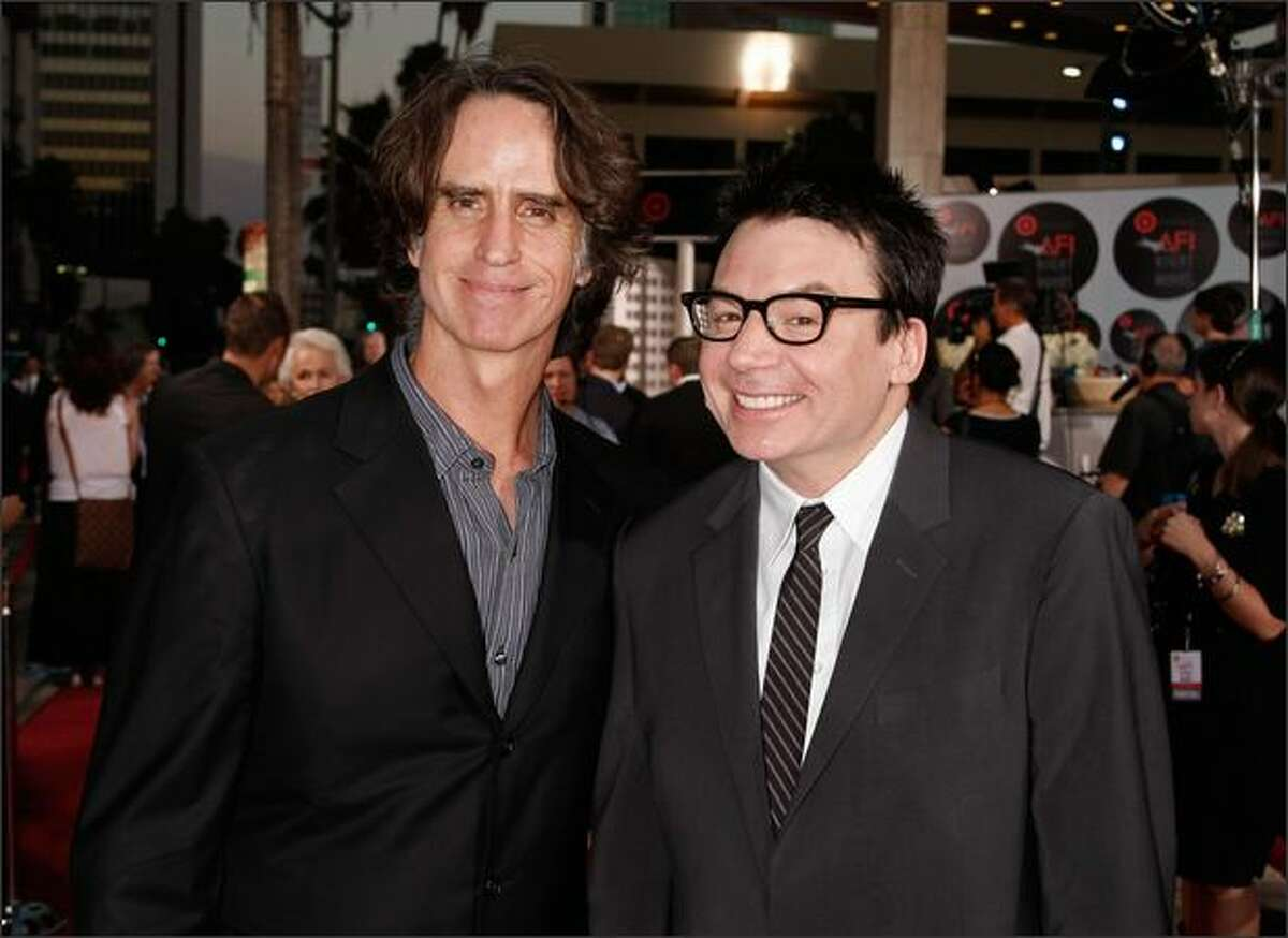 Director/producer Jay Roach (L) and actor Mike Myers arrive at AFI's Night At The Movies presented by Target held at ArcLight Cinemas on Wednesday in Hollywood, Calif.