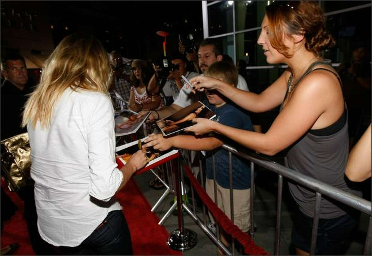 Actress Cameron Diaz signs an autograph as she arrives at AFI's Night At The Movies presented by Target held at ArcLight Cinemas on Wednesday in Hollywood, Calif.