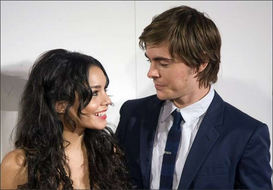 "Actors Zac Efron and Vanessa Anne Hudgens pose prior to the screening of the film ""High School Musical 3: Senior Year"" on Thursday in Madrid. Photo: Getty Images"