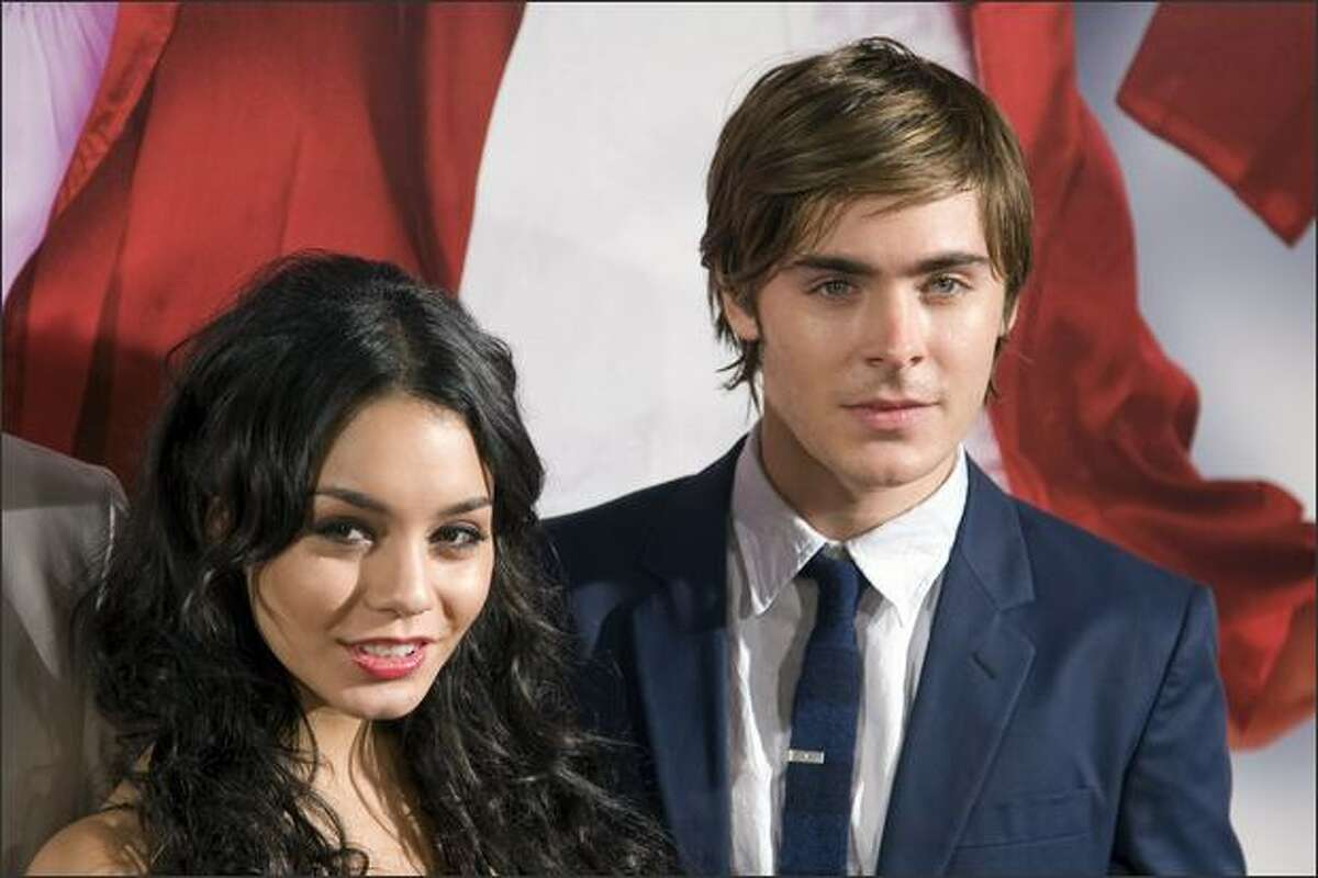 Actors Zac Efron and Vanessa Anne Hudgens pose prior to the screening of the film