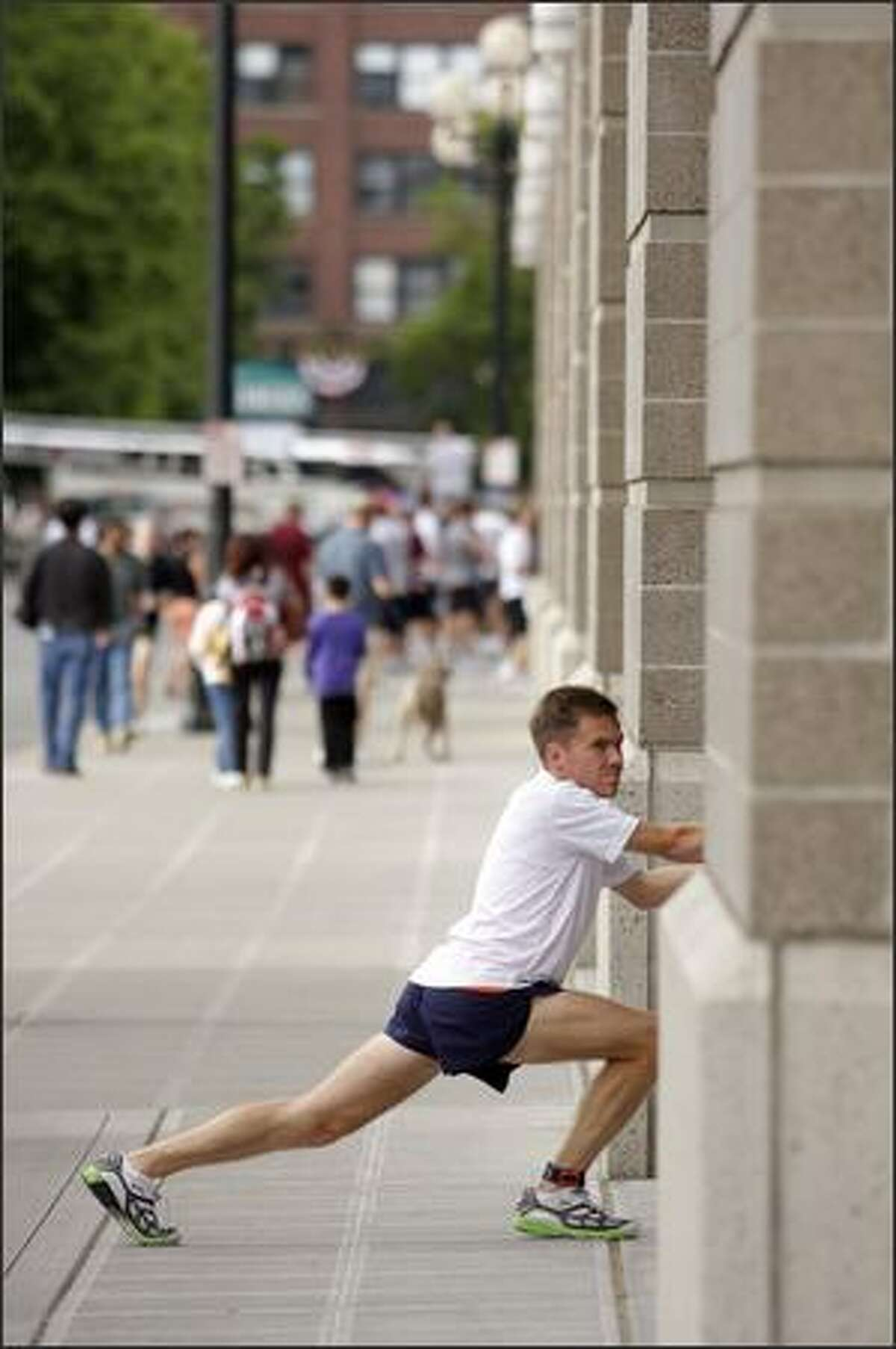 Sean Sundwall of Snoqualmie stretches outside of Quest Field prior to the start of the Torchlight Run at Seafair. He placed fifth in 2007.