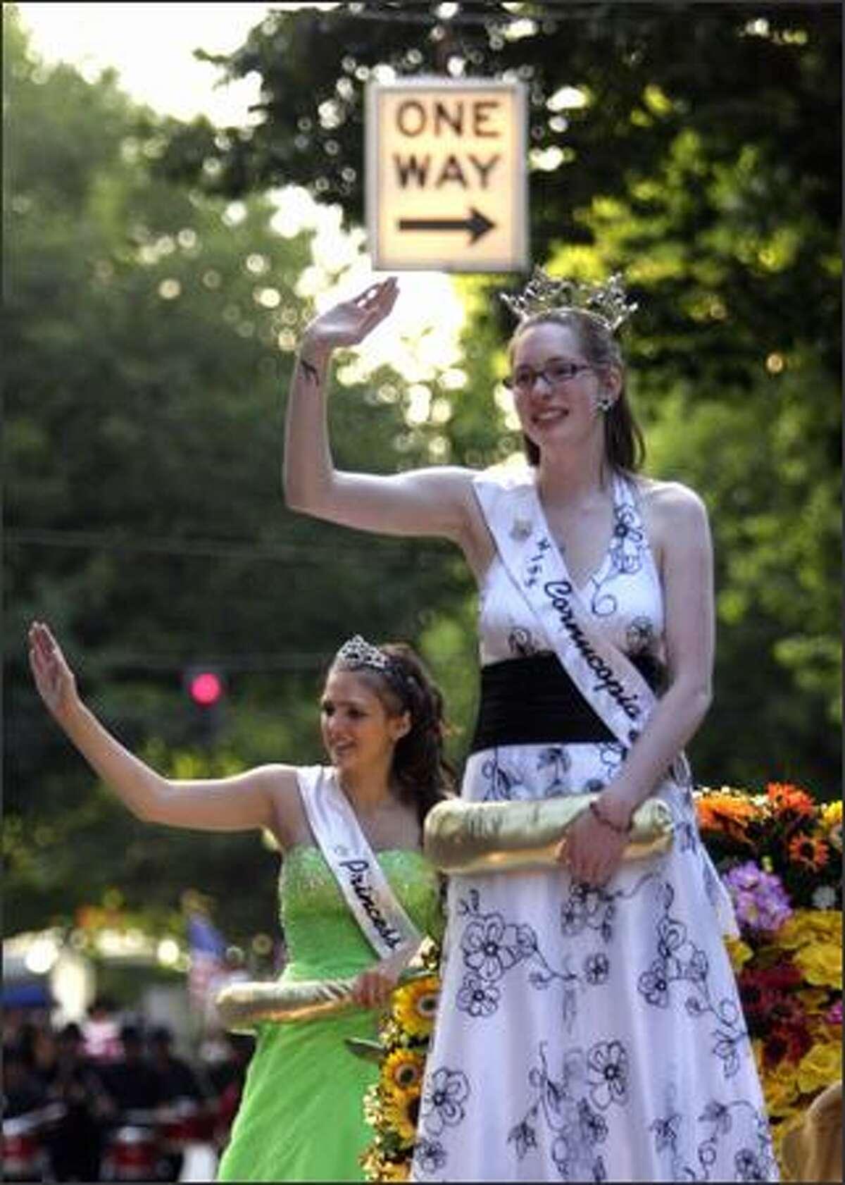Nicole Oliver, Miss Cornucopia 2008, and Tasha Nelson, the Royal Princess, ride upon the Kent Cornucopia Days float in the Torchlight Parade.