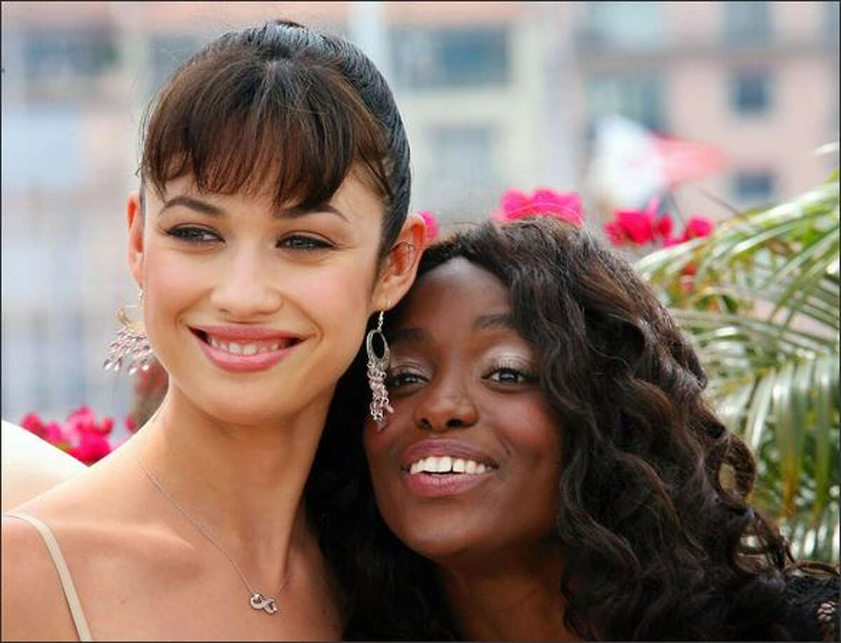 Ukrainian actress Olga Kurylenko and French actress Aissa Maiga pose during a photocall for the film 'Paris Je T'Aime' at the 59th edition of the International Cannes Film Festival in Cannes, Southern France, 18 May 2006. Competition gets underway in earnest at the Cannes Film Festival 18 May with films stoking controversy for their focus on pivotal political events fuelled by youthful dreams of freedom.