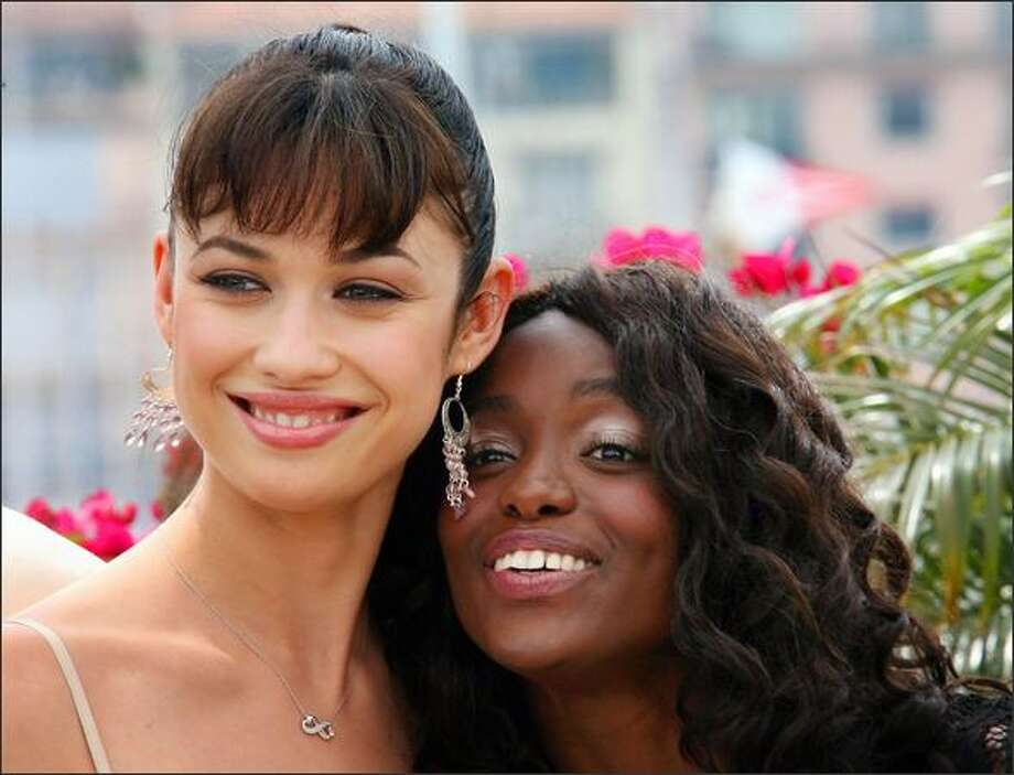 Ukrainian actress Olga Kurylenko and French actress Aissa Maiga pose during a photocall for the film 'Paris Je T'Aime' at the 59th edition of the International Cannes Film Festival in Cannes, Southern France, 18 May 2006. Competition gets underway in earnest at the Cannes Film Festival 18 May with films stoking controversy for their focus on pivotal political events fuelled by youthful dreams of freedom. Photo: Getty Images