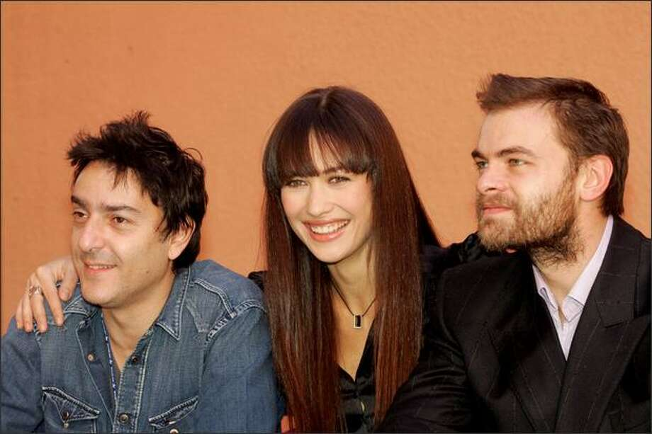 "French actor Clovis Cornillac, Olga Kurylenko (C) and Yvan Attal (L) pose during the photocall of the film ""Le Serpent"" (The Snake) during the International Film Festival of Marrakech on Dec. 8, 2006. Photo: Getty Images"