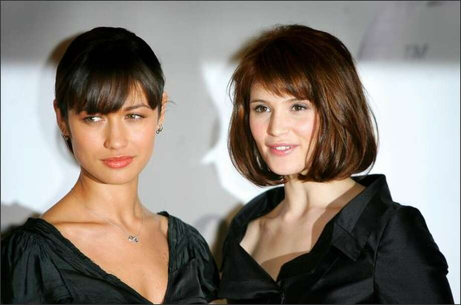 Actresses Olga Kurylenko (L) and Gemma Arterton attend a photocall to celebrate the start of production of the 22nd James Bond film 'Quantum of Solace' at Pinewood Studios on Jan. 24 near London, England. Photo: Getty Images