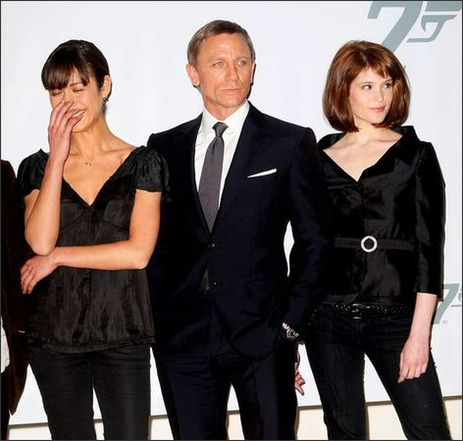 Actors (L-R) Olga Kurylenko, Daniel Craig and Gemma Arterton attend a photocall to celebrate the start of production of the 22nd James Bond film 'Quantum of Solace' at Pinewood Studios on Jan. 24 near London, England. Photo: Getty Images