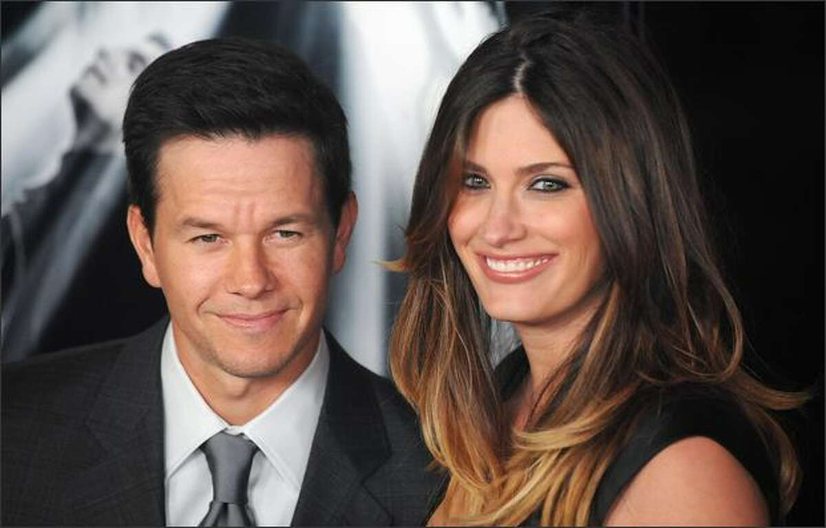 Cast members Mark Wahlberg (L) and an unidentified guest (R) arrive for the premiere of the
