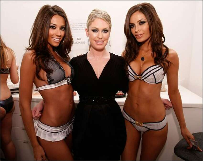 Designer Angela Chittenden poses with models backstage before the Beach Bunny Swimwear Spring 2009 fashion show during Mercedes-Benz Fashion Week held at Smashbox Studios on Monday in Culver City, Calif.