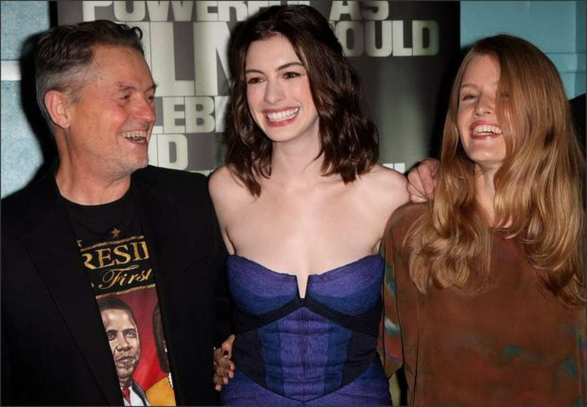 L-R Jonathan Demme, Anne Hathaway and Anisa George attend the premiere of 'Rachel Getting Married' at the BFI 52nd London Film Festival held at the Vue Cinema, Leicester Square in London, England.