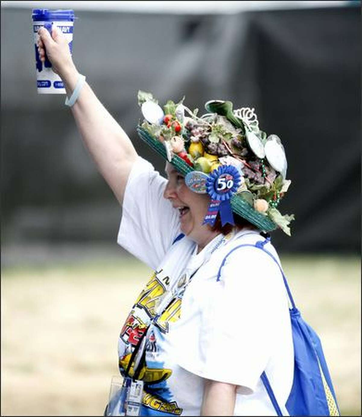 Beth Hughes and her hat named Carmen cheer for South by Northwest, the Navy rock band, at Seafair on Saturday.