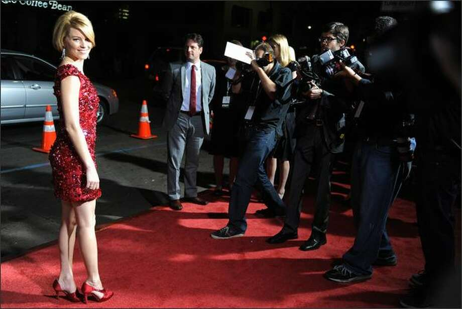 "Cast member Elizabeth Banks, left, arrives for the premiere of ""Zack and Miri Make a Porno"" at Grauman's Chinese Theater on Monday in Los Angeles. Photo: Getty Images"