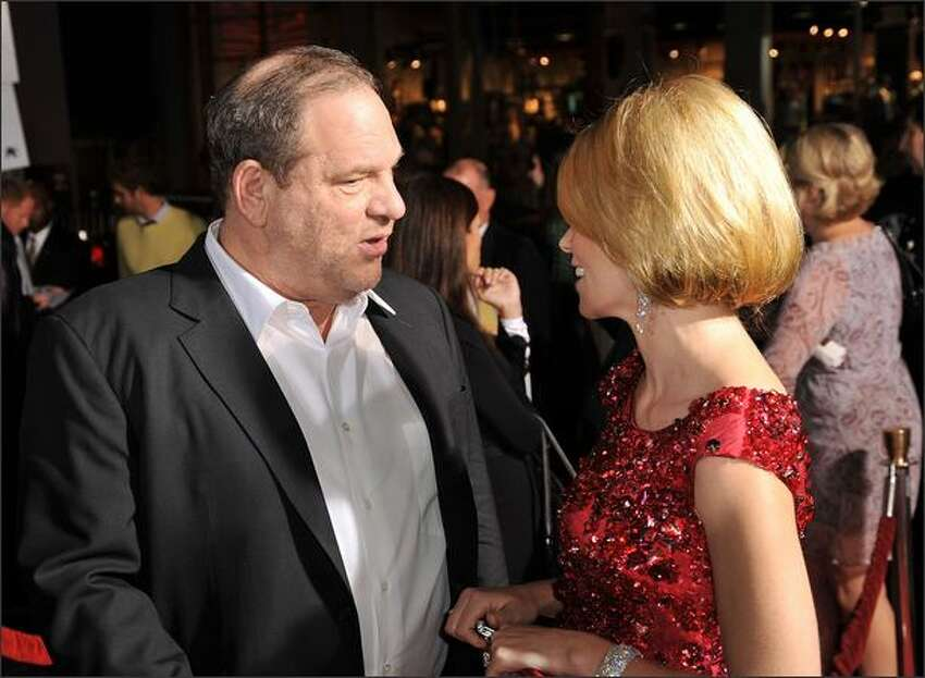 Executive producer Harvey Weinstein and actress Elizabeth Banks arrive at the