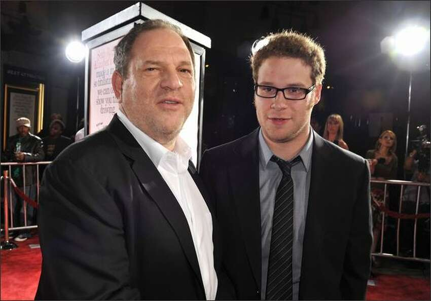Executive producer Harvey Weinstein and actor Seth Rogan arrive at the