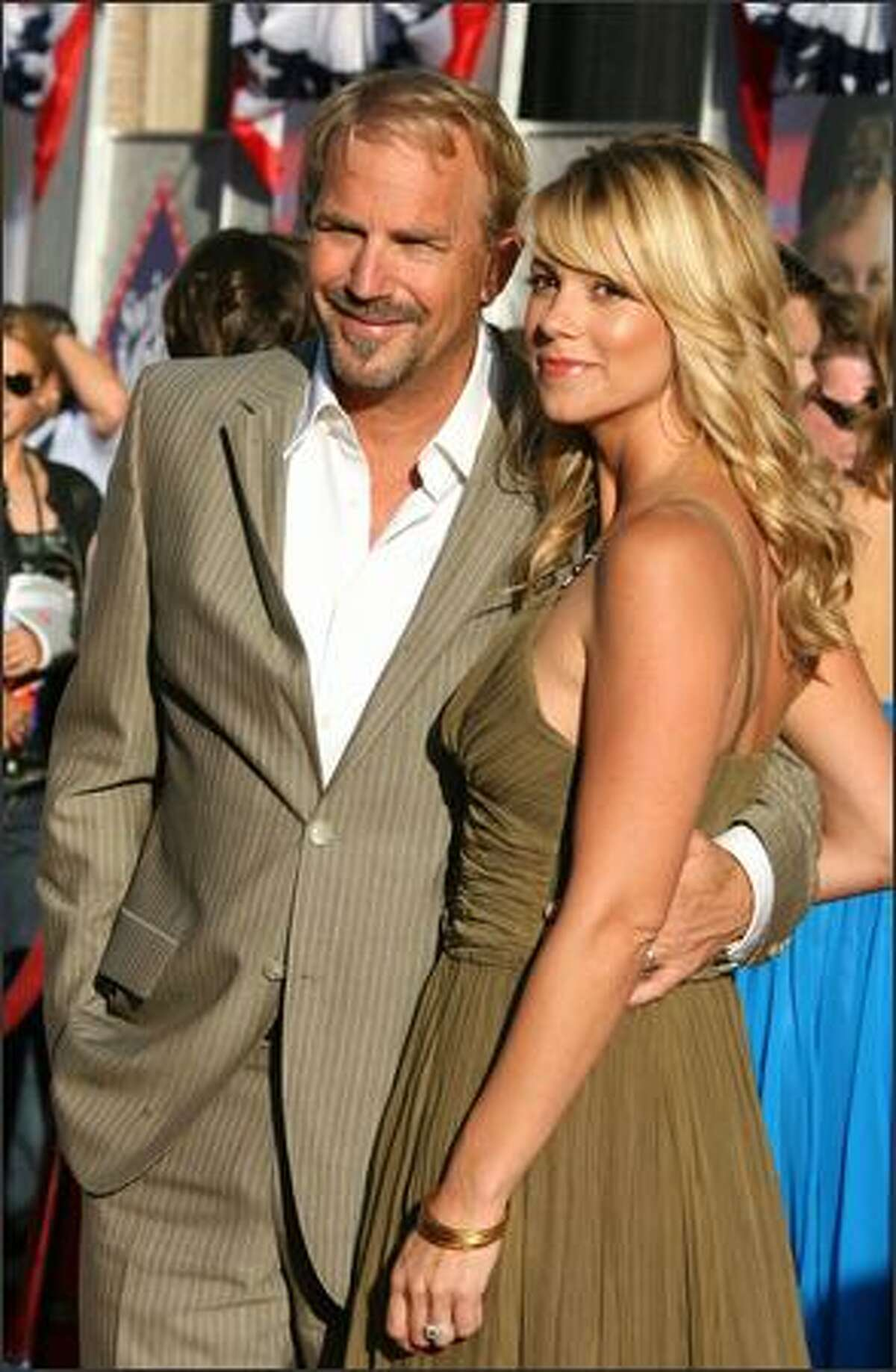 Actor Kevin Costner and Christine Baumgartner arrive at the premiere of Touchstone Pictures'