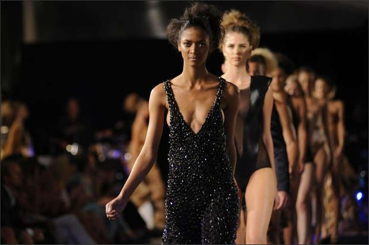 Models walk the runway wearing Adriana Degreas during Claro Rio Summer at Forte de Copacabana on Thursday in Rio De Janeiro, Brazil.