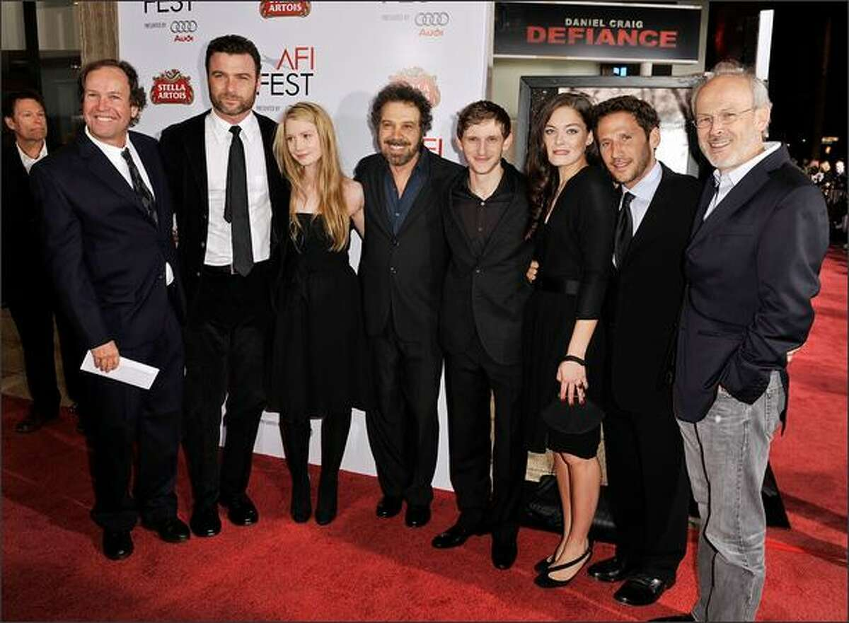 (L-R) Writer Clay Frohman, actor Liev Schreiber, actress Mia Wasikowska, writer/director Edward Zwick, actor Jamie Bell, actress Alexa Davalos, actor Mark Feuerstein and producer Pieter Jan Brugge arrive at the 2008 AFI FEST Closing Night Gala Screening of