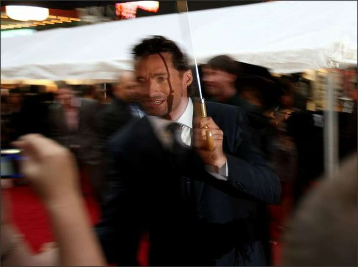 Hugh Jackman greets fans on the red carpet for the world premiere of