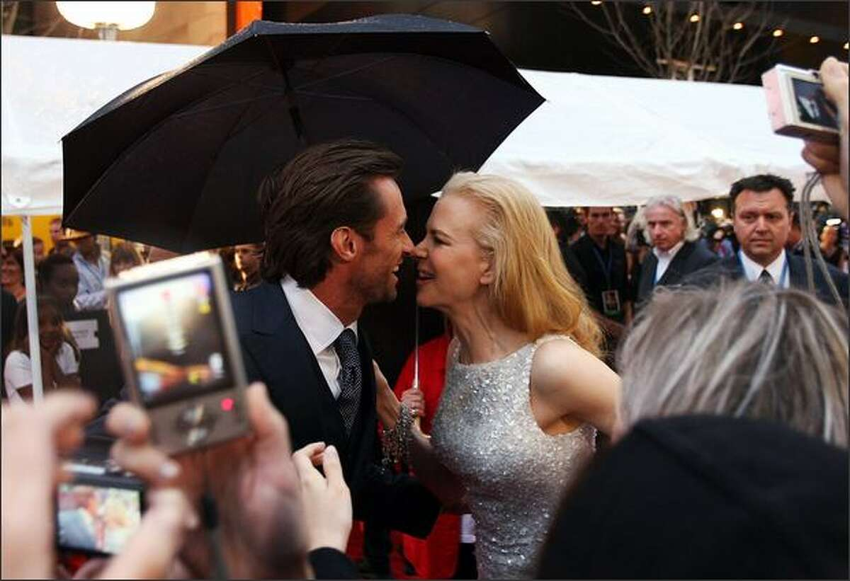 Hugh Jackman and Nicole Kidman greet each other on the red carpet for the world premiere of