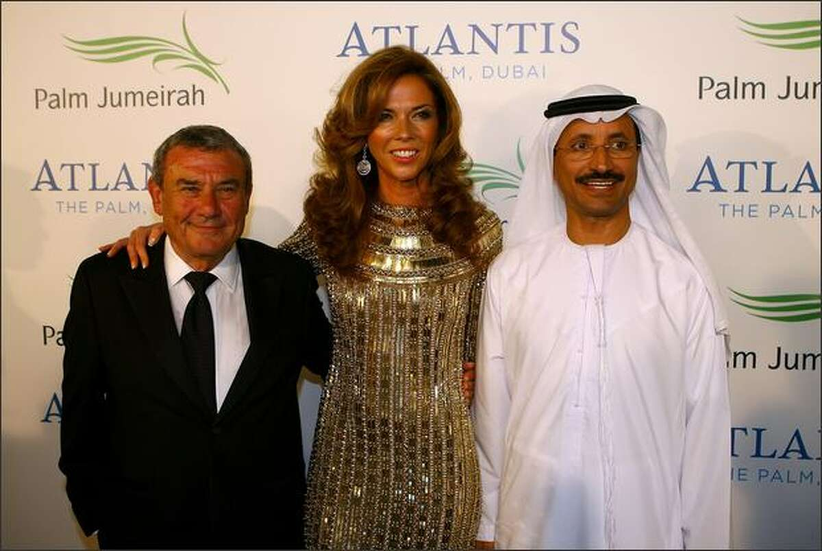 Sol Kerzner, Chairman and CEO of Kerzner International with his wife Heather Kerzner and His Excellency Sultan Ahmed Bin Sulayem, Chairman and CEO of Nakheel attend the landmark Grand Opening of Atlantis, The Palm Resort, and the Palm Jumeirah on Thursday in Dubai, United Arab Emirates.