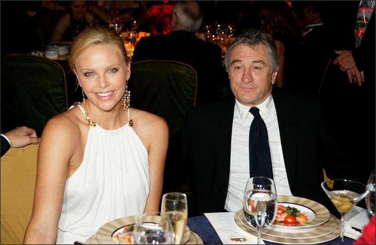 Charlize Theron and Robert De Niro (R) at the Grand Opening of Palm Jumeirah and its flagship Atlantis, the Palm Resort at the Palm Jumeirah Island on Thursday in Dubai, United Arab Emirates.