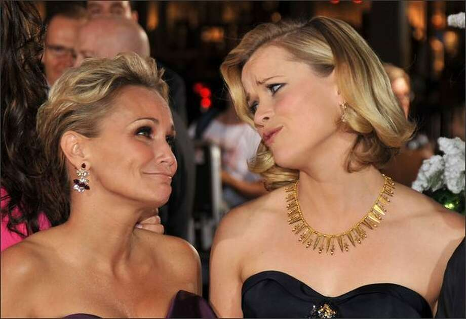 """(L-R) Actresses Kristin Chenoweth and Reese Witherspoon arrive on the red carpet of the Los Angeles Premiere of """"Four Christmases"""" held at the Grauman's Chinese Theater on Thursday in Hollywood, Calif. Photo: Getty Images"""