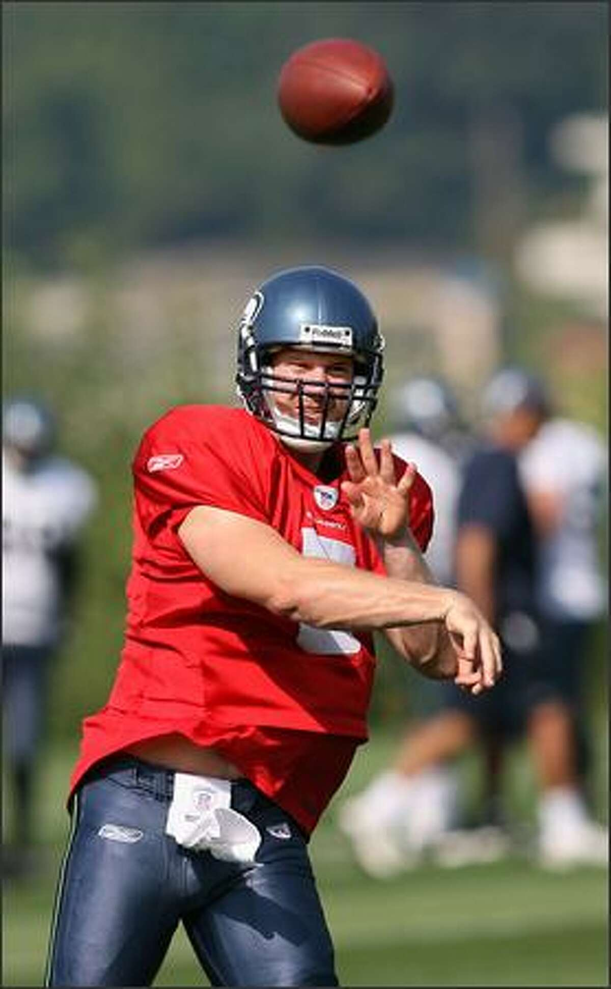 Backup quarterback Charlie Fry fires a pass as the Seahawks hold their first practice at their new practice facility.