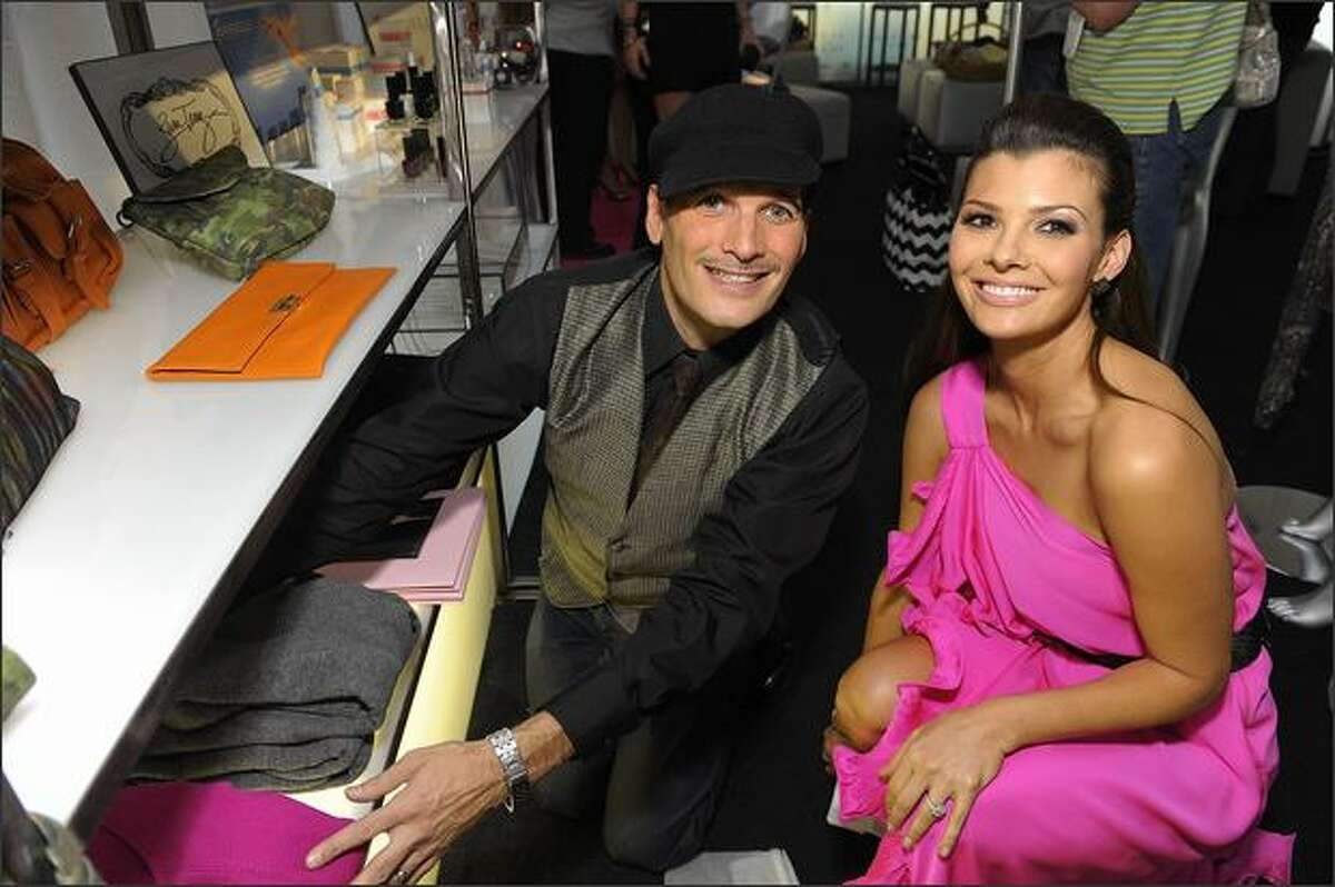 Stylist Phillip Bloch, left, and actress Ali Landry pose in the Official Silver Spoon Gifting Lounge held during the 2008 American Music Awards at the Nokia Theatre on Sunday in Los Angeles.
